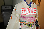kimono with large sale sign by entrance of store