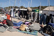 Refugees and migrants rest at a transit camp on the outskirts of Molyvos, Lesvos island, Greece.