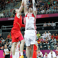 04 August 2012: Russia Timofey Mozgov dunks the ball over Spain Pau Gasol during 77-74 Team Russia victory over Team Spain, during the men's basketball preliminary, at the Basketball Arena, in London, Great Britain.