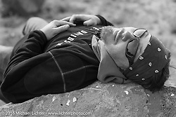 Jason Sims takes a break during Stage 13 (257 miles) of the Motorcycle Cannonball Cross-Country Endurance Run, which on this day ran from Elko, NV to Meridian, Idaho, USA. Thursday, September 18, 2014.  Photography ©2014 Michael Lichter.