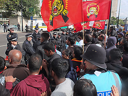 © licensed to London News Pictures. London, UK. 6/06/12. Demonstration takes place outside the Hilton Hotel, Park lane, over the attendance of the Sri Lankan president Mahinda Rajapaksa, accused of presiding over human rights abuses, at the Commonwealth Lunch with the Queen. Photo credit: Jules Mattsson/LNP