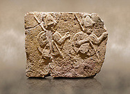 Photo of Hittite relief sculpted orthostat stone panel of Long Wall Limestone, Karkamıs, (Kargamıs), Carchemish (Karkemish), 900-700 B.C. . Anatolian Civilisations Museum, Ankara, Turkey. Two helmeted soldiers in short skirt carry shield on their backs and spear in their hands.<br /> <br /> On a brown art background. .<br />  <br /> If you prefer to buy from our ALAMY STOCK LIBRARY page at https://www.alamy.com/portfolio/paul-williams-funkystock/hittite-art-antiquities.html  - Type  Karkamıs in LOWER SEARCH WITHIN GALLERY box. Refine search by adding background colour, place, museum etc.<br /> Visit our HITTITE PHOTO COLLECTIONS for more photos to download or buy as wall art prints https://funkystock.photoshelter.com/gallery-collection/The-Hittites-Art-Artefacts-Antiquities-Historic-Sites-Pictures-Images-of/C0000NUBSMhSc3Oo