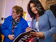 27 APRIL 2019 - STUART, IOWA: US Representative TULSI GABBARD, (D-HI) a candidate for the Democratic nomination for the US presidency, signs an autograph after her speech at the Reaching Rural Voters Forum in Stuart. The forum was an outreach by Democrats in Iowa's 3rd Congressional District to mobilize Democratic voters statewide. Iowa saw one of the largest shifts from Democrats to Republicans in the 2016 Presidential election and Trump won the state by double digits. Republicans control the governor's office and both chambers of the Iowa legislature. Iowa traditionally hosts the the first selection event of the presidential election cycle. The Iowa Caucuses will be on Feb. 3, 2020.     PHOTO BY JACK KURTZ