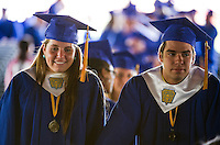 Valedictorian Sophie Czerwinski and Class President Andrew Caulfield are each in their own thoughts moments before leading their classmates toward the stage to begin Gilford High School's 2015 commencement at Bank of NH Meadowbrook Pavillion on Saturday morning.  (Karen Bobotas/for the Laconia Daily Sun)
