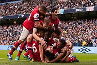 Football - Premier League - Manchester City vs. Arsenal<br /> Arsenal's Laurent Koscielny celebrates his equalising goal at the Etihad Stadium