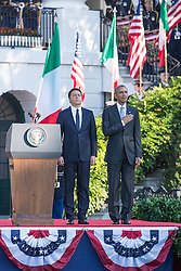 October 18, 2016 - Washington, DC, United States - On the South Lawn  of the White House in Washington, D.C., U.S., on Tuesday, Oct. 18, 2016., (l-r), Italian Prime Minister Matteo Renzi, and President Barack Obama, stand at attention during the ceremony at the Official State Visit. This was the last Official State Visit for the Obama administration. (Credit Image: © Cheriss May/NurPhoto via ZUMA Press)