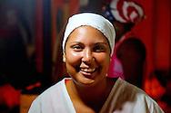 Woman selling food at night in Gibara at the Festival del Cinema Pobre, Holguin Province, Cuba.