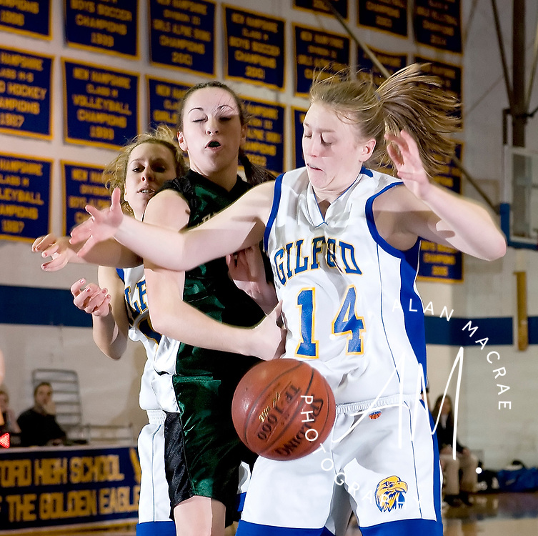 Gilford's Kelsey Graaskamp wrestles for the ball with Newfound's Caitlin O'Connor during Tuesday's game at Gilford.  (Alan MacRae/for the Citizen)