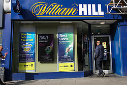 © Licensed to London News Pictures. 09/09/2021. London, UK. A man enters a branch of William Hill betting shop in north London. Online gambling group 888 has agreed a £2.2 billion deal to buy William Hill's European business and its 1,400 UK betting shops in a move that will see it return to British hands. Photo credit: Dinendra Haria/LNP