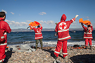 The Hellenic Red Cross signals a boat of migrants and refugees towards a stretch of beach near Molyvos, Lesvos island, Greece.