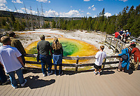 Morning Glory Pool  and tourists in Yellowstone National Park, Wyoming, USA.