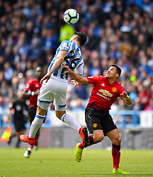 Huddersfield Town's Christopher Schindler (left) and Manchester United's Alexis Sanchez battle for the ball during the Premier League match at the John Smith's Stadium, Huddersfield.