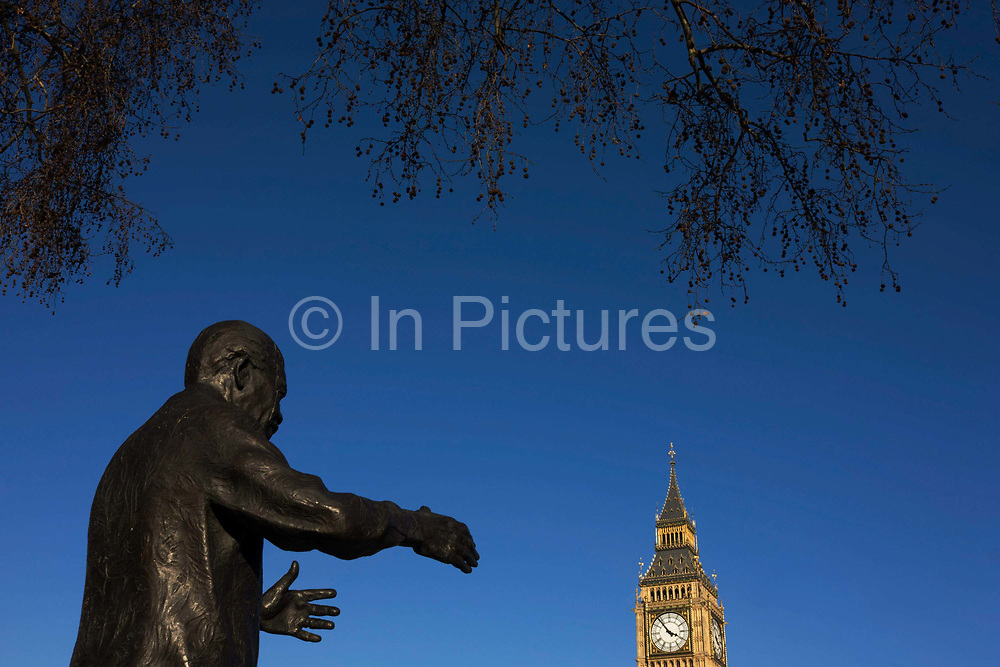 The reaching hands of ex-South African President Nelson Mandela's statue seemingly grasp the Big Ben clock tower in Parliament Square, Westminster, central London. The late South African anti-apartheid activist Donald Woods had the idea for the 9ft-high (2.7m) bronze statue, unveiled in August 2007.