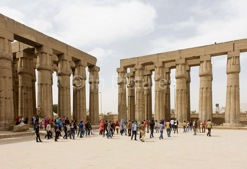 Tourist groups stand and photograph beneath the giant columns in the Solar Court of Amenhotep III, at the ancient Egyptian Luxor Temple, Nile Valley, Egypt. According to the country's Ministry of Tourism, European visitors to Egypt is down by up to 80% in 2016 from the suspension of flights after the downing of the Russian airliner in Oct 2015. Euro-tourism accounts for 27% of the total flow and in total, tourism accounts for 11.3% of Egypt's GDP. The temple was built by Amenhotep III, completed by Tutankhamun then added to by Rameses II. Towards the rear is a granite shrine dedicated to Alexander the Great and in another part, was a Roman encampment. The temple has been in almost continuous use as a place of worship right up to the present day.