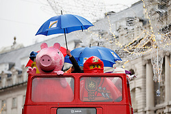 © Licensed to London News Pictures. 20/11/2016. London, UK. Cartoon mascots and over 400 cast members of Hamley's Toy Parade march along Regent Street in London in a colourful extravaganza, with marching bands, dancers and toy vehicles. Photo credit: Tolga Akmen/LNP