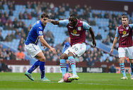 Christian Benteke has a shot during the The FA Cup match between Aston Villa and Leicester City at Villa Park, Birmingham, England on 15 February 2015. Photo by Alan Franklin.