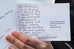© Licensed to London News Pictures. 21/02/2018. London, UK. A letter of support for Nazanin Zaghari-Ratcliffe is held by a protester outside the Iranian Embassy in London, ahead of an expected visit by a senior Iranian minister. British-Iranian Nazanin Zaghari-Ratcliffe has been detained in Iran since April 2016. Photo credit: Rob Pinney/LNP