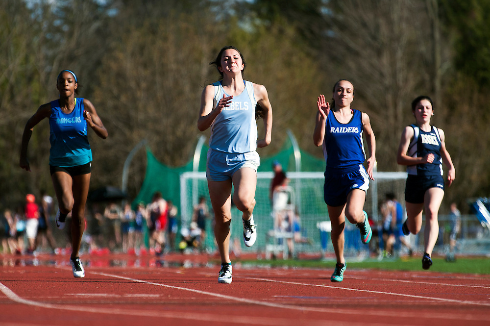 South Burlington's Kayla Gilding competes in the 400m dash during the Burlington track and field invitational at Burlington high school on Saturday afternoon May 2, 2015 in Burlington, Vermont. (BRIAN JENKINS, for the Free Press)