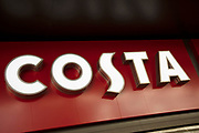 Sign for the coffee shop and brand Costa in Birmingham, United Kingdom.