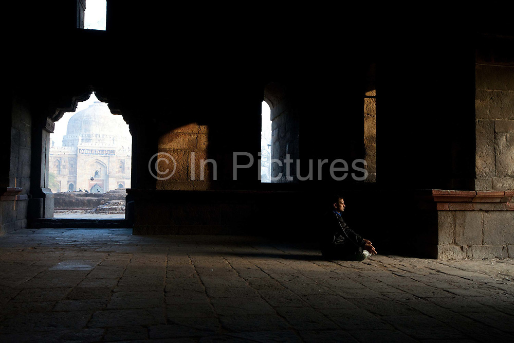 A man meditates at dawn in the Bara Gumbad tomb in Lodi Gardens, New Delhi, India. The site is now protected by the Archeological Survey of India. The gardens are a hotspot for morning walks for the Delhiites.
