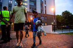 **NOTE TO EDITORS: Young children are pictured**<br /> © Licensed to London News Pictures. 23/06/2017. London, UK. Residents being evacuated from the Taplow block of the Chalcots Estate in Camden after it failed a fire inspection because of combustable cladding. Prime Minister Theresa May has told Parliament that up to 600 high rise tower blocks may have similar cladding to that found in Grenfell Tower, which went on fire last week, in which as many as 79 residents are thought to have perished Photo credit: Ben Cawthra/LNP