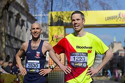 Competitors cross the finish line during the 2019 London Landmarks Half Marathon.
