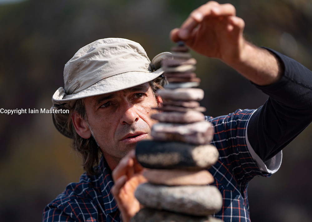 Dunbar, Scotland, UK. 20 April, 2019. Pedro Duran builds his stone stack during the 30 minutes height competition  on Eye Cave beach in Dunbar during opening day of the European Stone Stacking Championship 2019.