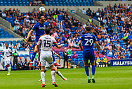 Cardiff City forward Kieffer Moore (10) heads clear during the EFL Sky Bet Championship match between Cardiff City and Bournemouth at the Cardiff City Stadium, Cardiff, Wales on 18 September 2021.