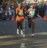 Jonathan Ndambuki <cq>, left and Kassohad Kabiso <cq>, right, are in a all-out sprint to the finish of the California International Marathon finish at the state Capitol.  Ndambuki won the race by a stride in a time of 2 hours 14minutes and 58 seconds.  Kabiso was 1.6 seconds behind.  Sunday, December 3, 2006.  Sacramento Bee/  Jay Mather