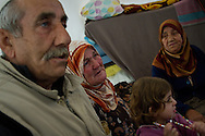 An elderly woman cries as she hears news of recent attacks by the Syrian military in her hometown of Jisr Ash-Shughur, from where her daughter and grandchildren are still trying to flee to the Turkish border. Reyhanli refugee camp, Turkey.