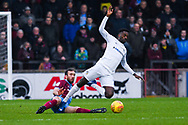 Rory McArdle of Scunthorpe United (23) fouls Jordy Hiwula of Coventry City (11) during the EFL Sky Bet League 1 match between Scunthorpe United and Coventry City at Glanford Park, Scunthorpe, England on 5 January 2019.
