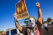 "20 MARCH 2012 - PHOENIX, AZ: A demonstrator dresses in ""Lucha Libre"" (Mexican wrestling) mask during a student protest in support of the DREAM Act on 75th Ave in front of Trevor G. Browne High School Tuesday.  PHOTO BY JACK KURTZ"