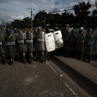 Soldiers of the Honduran Army on the streets of the capital Tegucigalpa ready to repel a protest. Later the soldiers used teargas and batons against the protestors.