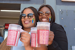 Pretoria 26-12-18. The 1st of three 5 day cricket Tests, South Africa vs Pakistan at SuperSport Park, Centurion. Day 1. Tshiamo Mashabela and Khanyi Malongete from Krugersdorp try keep cool after buying something to drink  as temperatures soared to around 35deg Celcius.<br /> Picture: Karen Sandison/African News Agency(ANA)