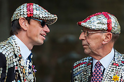 © Licensed to London News Pictures. 25/09/2016. London, UK. Pearly Kings and Queens celebrate Harvest Festival in Guildhall Yard.  The 140 year old tradition involves wearers of dark suits covered in hundreds of brightly coloured pearl buttons gathering in the capital to celebrate the biggest event in the Pearly calendar.  Photo credit : Stephen Chung/LNP