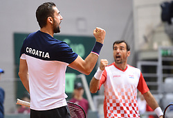OSIJEK, Feb. 4, 2018  Marin Cilic (L) and Ivan Dodig of Croatia celebrate during the third match against Daniel Nestor and Vasek Pospisil of Canada at Davis Cup World Group first round match between Croatia and Canada in Osijek, Croatia, on Feb. 3, 2018. (Credit Image: © Marko Prpic/Pixsell/Xinhua via ZUMA Wire)