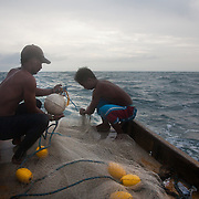 The crew fish using trawl which is cast from the stern. The net is the shape of an open sack with weights on each side and when the net is out the boat cruises along for an hour to catch the fish.  <br /> <br /> Joseph is 17 and works like his father did on the sea as a fisherman. The catch of the day is hauled in by the entire crew to be sorted out on deck and taken straight to the market in Hinigaran. The catch that day made the crew $12.00 each( Captain Joan $24.00) One day a week Joseph goes to Alternative Learning schooling provided by Quidan-Kaisahan.  Quidan-Kaisahan is a charity working in Negros Occidental in the Philippines. Their aim is to keep children out of work to secure them education.