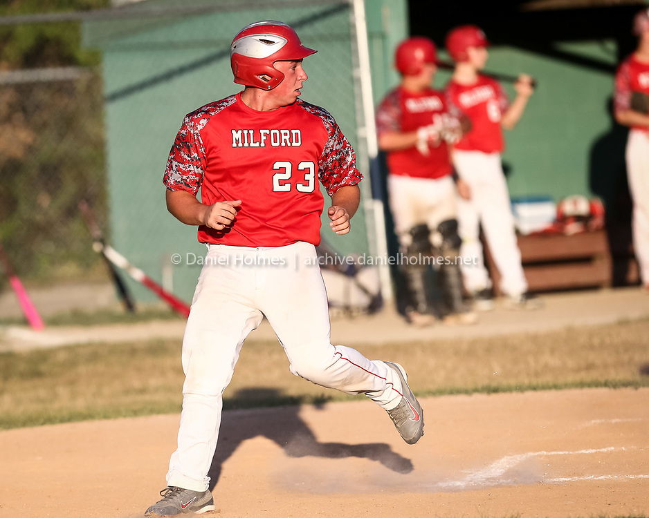 (7/26/16, MILFORD, MA) Milford's Brendan Cambrola comes in to score during the Senior Babe Ruth baseball playoff game against Medway at Fino Field in Milford on Tuesday. Daily News and Wicked Local Photo/Dan Holmes