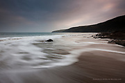 Waves at Porth Ceiriad near Abersoch, Llyn Peninsula, North Wales.  West Anglesey at dusk. Gentle waves on a long sandy look soft because of motion blur.