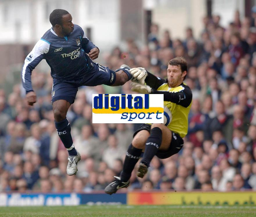 Photo: Daniel Hambury.<br />West Ham United v Manchester City. The Barclays Premiership. 15/04/2006.<br />West Ham's James Walker saves bravely from City's Darius Vassell.
