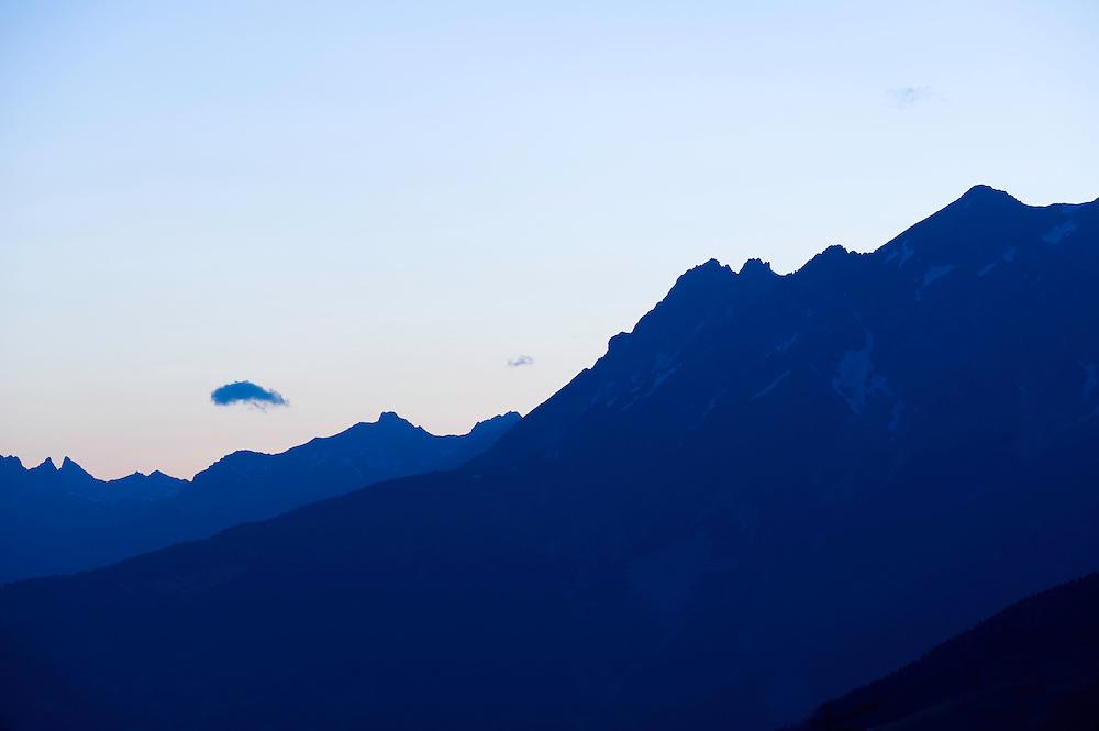 IFTE-NB-007868; Niall Benvie; View from Kaunerberg; Tirol; Austria; Europe; ötztaler Alps; mountains forest; horizontal; high pointed steep treeline; green white blue; upland mountain hill slope woodland forest; 2008; July; summer; evening dusk; Wild Wonders of Europe Naturpark Kaunergrat