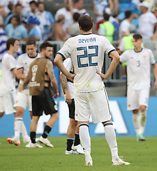 SAMARA, June 25, 2018  Artem Dzyuba (front) of Russia reacts after the 2018 FIFA World Cup Group A match between Uruguay and Russia in Samara, Russia, June 25, 2018. Uruguay won 3-0. Russia and Uruguay advanced to the round of 16. (Credit Image: © Bai Xueqi/Xinhua via ZUMA Wire)