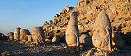 Statue heads, from right, Herekles, Apollo, Zeus, Commagene, Antiochus, & Eagle,  62 BC Royal Tomb of King Antiochus I Theos of Commagene, east Terrace, Mount Nemrut or Nemrud Dagi summit, near Adıyaman, Turkey .<br /> <br /> If you prefer to buy from our ALAMY PHOTO LIBRARY  Collection visit : https://www.alamy.com/portfolio/paul-williams-funkystock/nemrutdagiancientstatues-turkey.html<br /> <br /> Visit our CLASSICAL WORLD HISTORIC SITES PHOTO COLLECTIONS for more photos to download or buy as wall art prints https://funkystock.photoshelter.com/gallery-collection/Classical-Era-Historic-Sites-Archaeological-Sites-Pictures-Images/C0000g4bSGiDL9rw