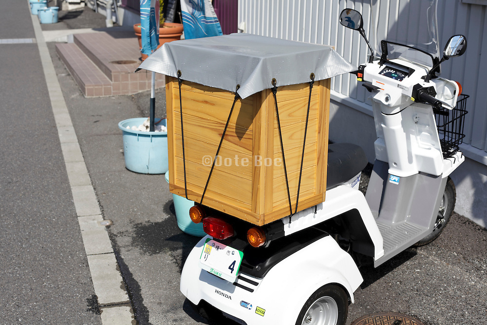three wheeled delivery scooter with wooden box on the back Japan