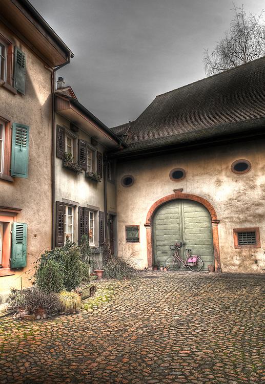 Bicycle leaning on barn doors in Rheinfelden