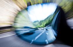 04.05.2011, Schwarzarch, AUT, FEATURE VERKEHR, im Bild Gegenverkehr, PKW im Rückspiegel eines Autos das im Stau steht, THEMENBILD STAU, VERKEHR, Langzeitbelichtung, zommeffekt // Oncoming traffic in the rearview mirror of a car in the traffic jam, THEME IMAGE/ Feature TRAFFIC JAM, TRANSPORT, long exposure, zommeffekt, EXPA Pictures © 2011, PhotoCredit: EXPA/ J. Feichter