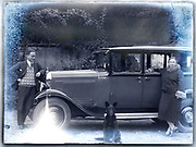 deteriorating glass plate with couple posing with dog by their car France ca 1930s