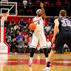 J.J. Moore #44 of the Rutgers Scarlet Knights directs the play during Rutgers men's basketball vs Temple Owls in American Athletic Conference play on Jan. 1, 2014 at Rutgers Louis Brown Athletic Center in Piscataway, New Jersey.