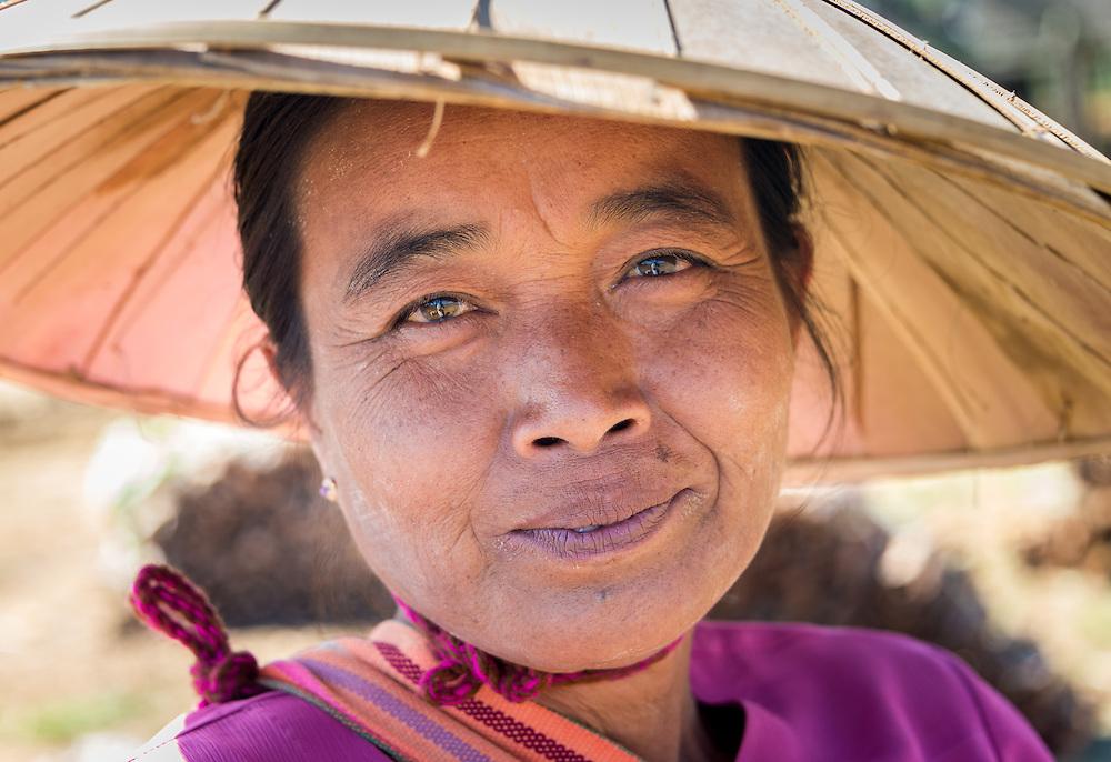 INLE LAKE, MYANMAR - CIRCA DECEMBER 2013: Portrait of burmese woman in the Taung Tho Market in Inle Lake, Myanmar