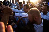 Tykocin, woj. podlaskie, 22.07.2021. Wizyta premiera Mateusza Morawieckiego w wojewodztwie podlaskim. Premier byl gosciem specjalnym Pikniku Rodzinnego zorganizowanego przez Urzad Marszalkowski Wojewodztwa Podlaskiego (UMWP), gdzie spotkal sie mieszkancami oraz promowal sztandarowy program rzadu POLSKI LAD. N/z premier Mateusz Morawiecki po spotkaniu wszedl w tlum ludzi i romawial oraz robil selfie z niemal kazdym chetnym fot Michal Kosc / AGENCJA WSCHOD